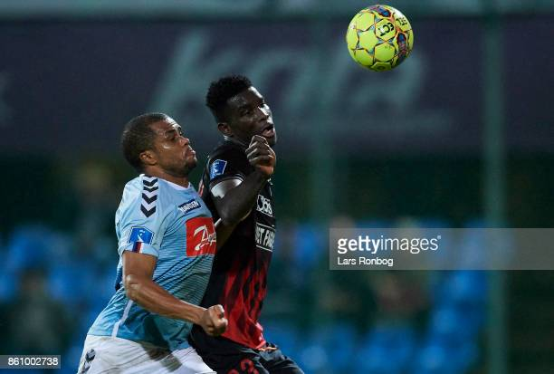 Ramon Rodrigues of Sonderjyske and Paul Onuachu of FC Midtjylland compete for the ball during the Danish Alka Superliga match between Sonderjyske and...