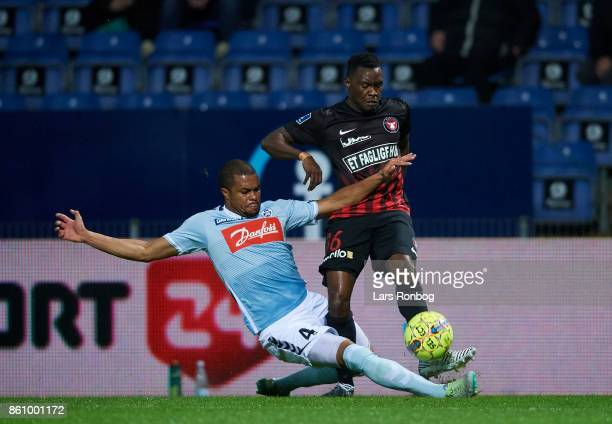 Ramon Rodrigues of Sonderjyske and Rilwan Hassan of FC Midtjylland compete for the ball during the Danish Alka Superliga match between Sonderjyske...