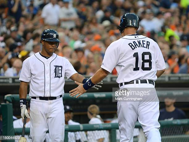 Ramon Santiago and Jeff Baker of the Detroit Tigers shake hands during the game against the New York Yankees at Comerica Park on August 8 2012 in...