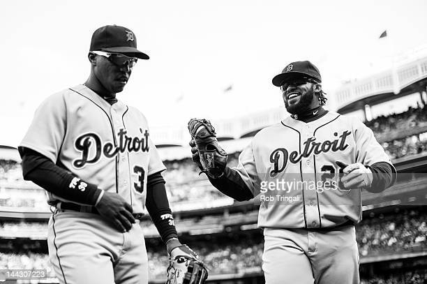 Ramon Santiago and Prince Fielder of the Detroit Tigers return to the dugout after completing another inning during the game against the New York...