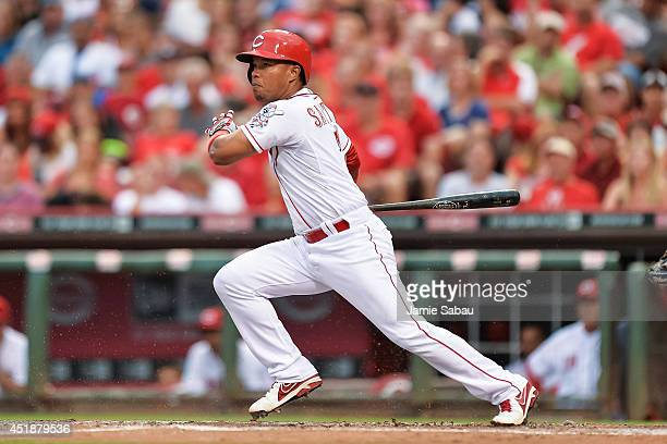 Ramon Santiago of the Cincinnati Reds bats against the Chicago Cubs at Great American Ball Park on July 7 2014 in Cincinnati Ohio