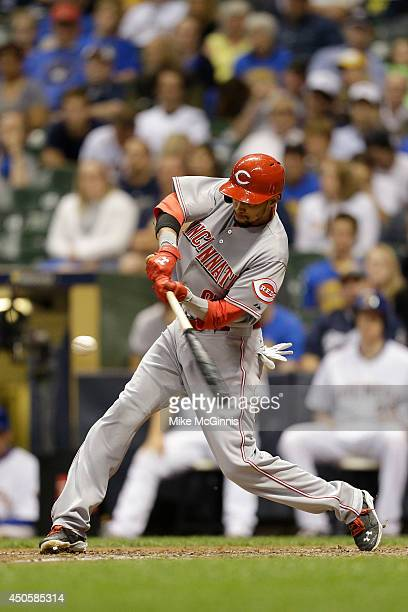 Ramon Santiago of the Cincinnati Reds hits a RBI double in the top of the ninth inning against the Milwaukee Brewers at Miller Park on June 13 2014...