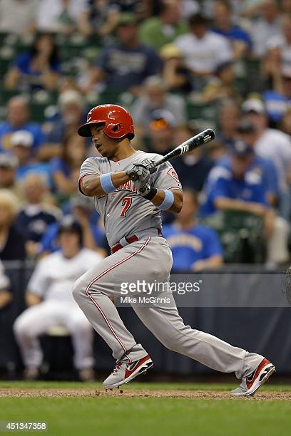 Ramon Santiago of the Cincinnati Reds makes some contact at the plate during the game against the Milwaukee Brewers at Miller Park on June 15 2014 in...