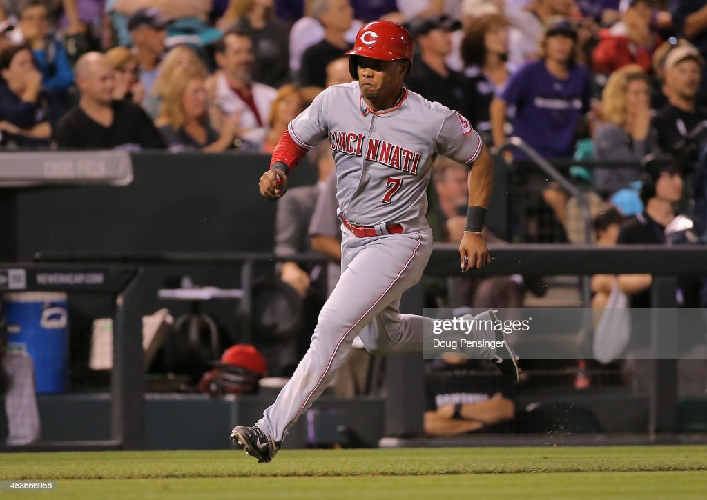 Ramon Santiago #7 of the Cincinnati Reds scrores the game winning run on a single by Kris Negron #17 of the Cincinnati Reds off of Adam Ottavino #0 of the Colorado Rockies in the ninth inning at Coors Field on August 15, 2014 in Denver, Colorado. The Reds defeated the Rockies 3-2.