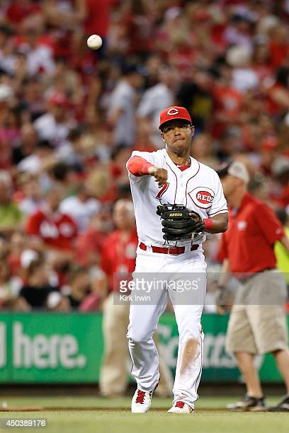 Ramon Santiago of the Cincinnati Reds throws the ball to first base during the game against the Philadelphia Phillies at Great American Ball Park on...