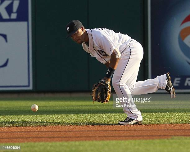 Ramon Santiago of the Detroit Tigers can't run down a base hit during a MLB interleague game against the St Louis Cardinals at Comerica Park on June...