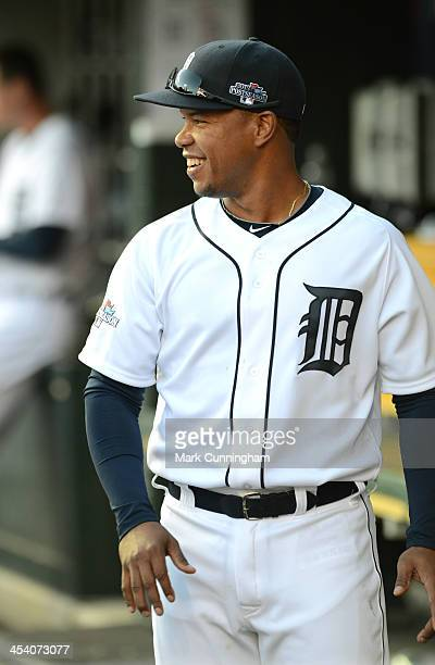 Ramon Santiago of the Detroit Tigers looks on from the dugout and smiles during Game Four of the American League Division Series against the Oakland...