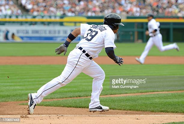 Ramon Santiago of the Detroit Tigers runs to first base during the game against the Cleveland Indians at Comerica Park on June 9 2013 in Detroit...