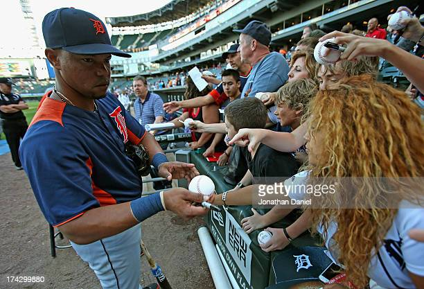 Ramon Santiago of the Detroit Tigers signs autographs before a game against the Chicago White Sox at US Cellular Field on July 23 2013 in Chicago...