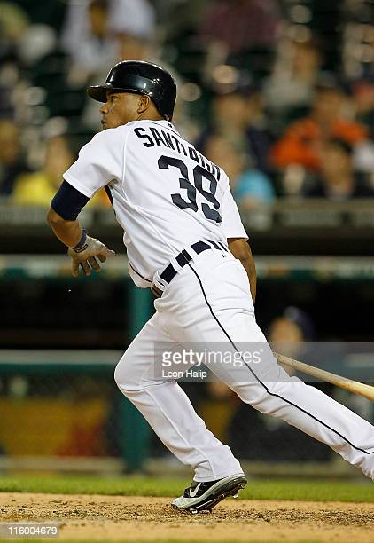 Ramon Santiago of the Detroit Tigers triples in the tenth inning scoring Victor Martinez as the Tigers defeated the Tampa Bay Rays 21 at Comerica...
