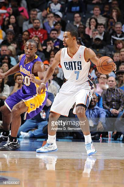 Ramon Sessions of the Charlotte Bobcats controls the ball against Jodie Meeks of the Los Angeles Lakers on February 8 2013 at the Time Warner Cable...