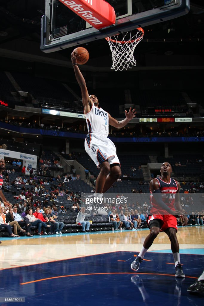 Ramon Sessions #7 of the Charlotte Bobcats goes to the basket during the game between the Charlotte Bobcats and the Washington Wizards at the Time Warner Cable Arena on October 7, 2012 in Charlotte, North Carolina.