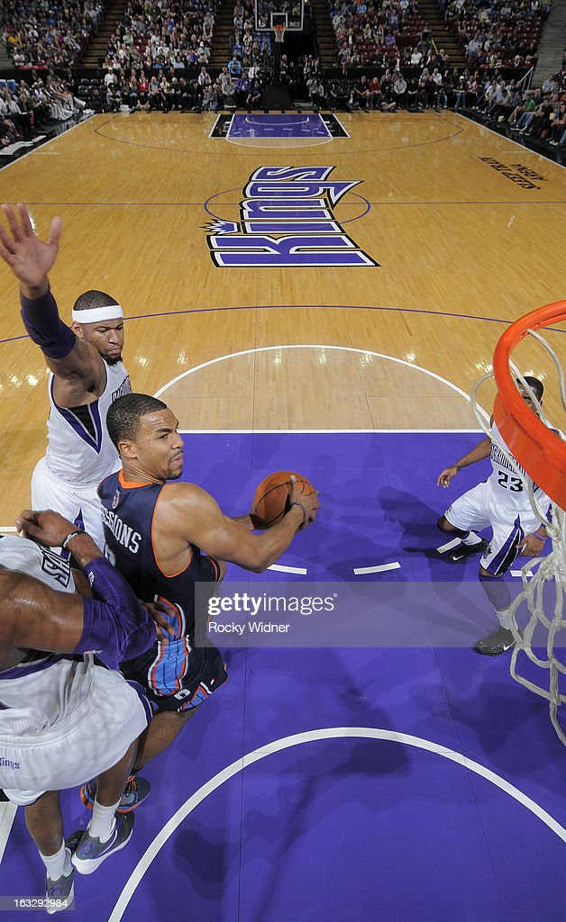 Ramon Sessions #7 of the Charlotte Bobcats goes up for the shot against DeMarcus Cousins #15 of the Sacramento Kings on March 3, 2013 at Sleep Train Arena in Sacramento, California.