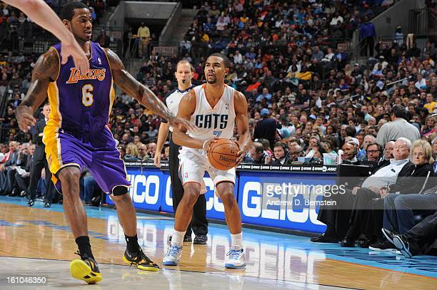 Ramon Sessions of the Charlotte Bobcats prepares to shoot against Earl Clark of the Los Angeles Lakers on February 8 2013 at the Time Warner Cable...