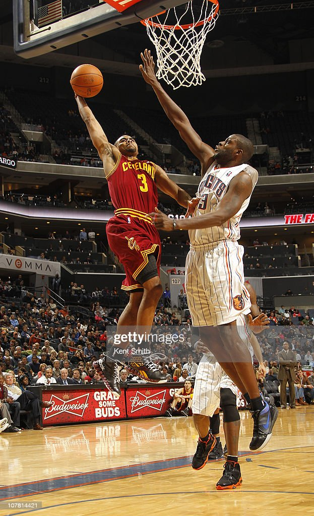 Ramon Sessions #3 of the Cleveland Cavaliers puts down a dunk over Nazr Mohammed #13 of the Charlotte Bobcats on December 29, 2010 at Time Warner Cable Arena in Charlotte, North Carolina.
