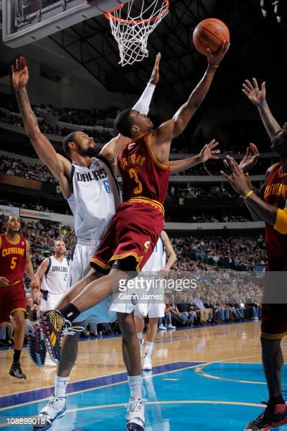 Ramon Sessions of the Cleveland Cavaliers shoots against Tyson Chandler of the Dallas Mavericks during a game on February 7 2011 at the American...