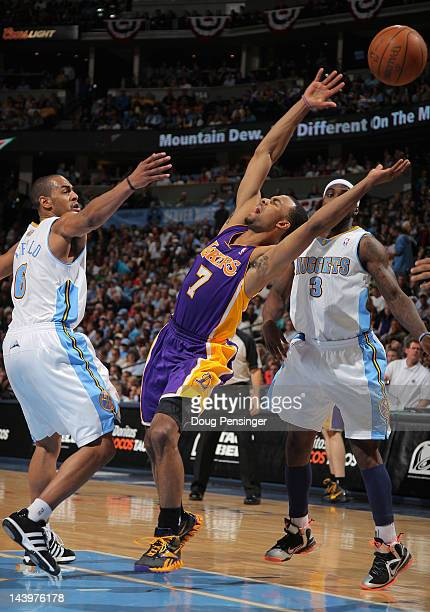 Ramon Sessions of the Los Angeles Lakers looses control of the ball against Arron Afflalo of the Denver Nuggets and Ty Lawson of the Denver Nuggets...