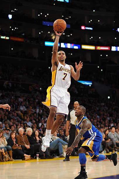 78b32422c Ramon Sessions  7 of the Los Angeles Lakers shoots against Nate Robinson  2  of