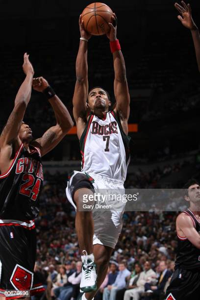 Ramon Sessions of the Milwaukee Bucks dunks and is fouled by Tyrus Thomas of the Chicago Bulls on April 14 2008 at the Bradley Center in Milwaukee...