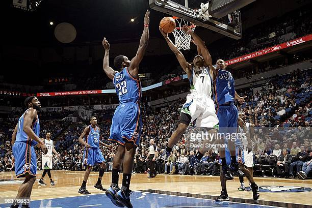 Ramon Sessions of the Minnesota Timberwolves goes to the basket against Jeff Green and Eric Maynor of the Oklahoma City Thunder during the game on...