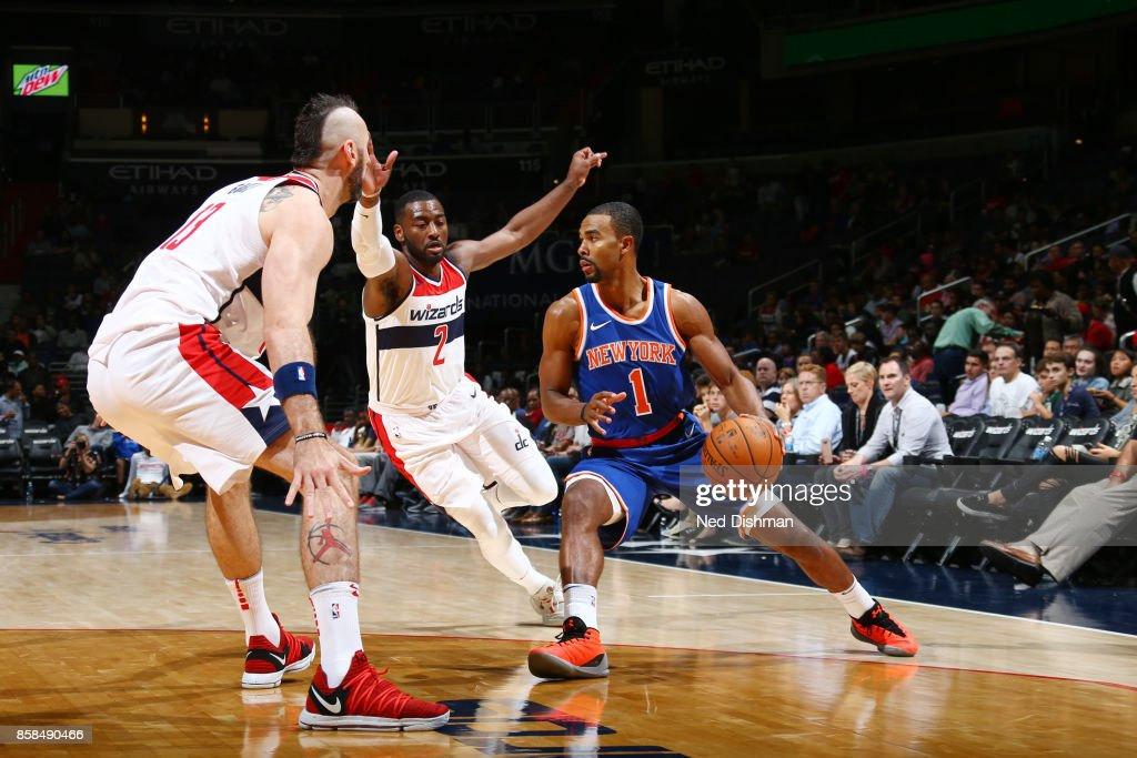 Ramon Sessions #1 of the New York Knicks handles the ball against John Wall #2 of the Washington Wizards during the preseason game on October 6, 2017 at Capital One Arena in Washington, DC.