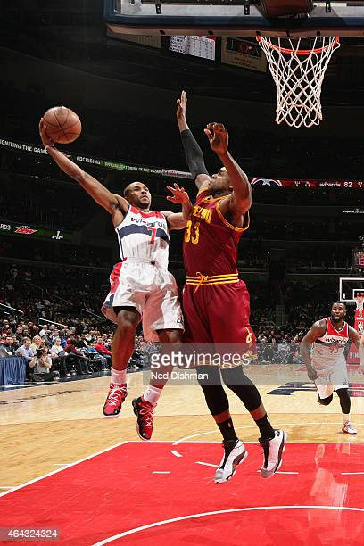 Ramon Sessions of the Washington Wizards shoots against the Brendan Haywood of the Cleveland Cavaliers on February 20 2015 at Verizon Center in...