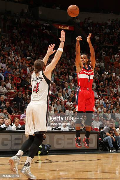 Ramon Sessions of the Washington Wizards shoots against the Josh McRoberts of the Miami Heat during the game on December 7 2015 at American Airlines...