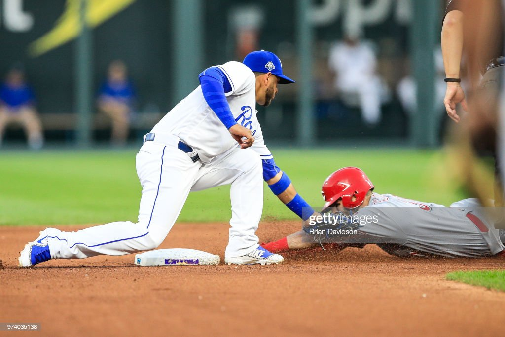 Ramon Torres #46 of the Kansas City Royals tags out Curt Casali #38 of the Cincinnati Reds during the sixth inning at Kauffman Stadium on June 13, 2018 in Kansas City, Missouri.