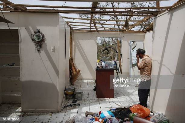 Ramon Torres stands in what is left of his sisterinlaw's home that was destroyed when Hurricane Maria passed through on September 27 2017 in Corozal...