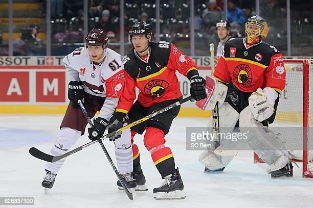 Ramon Untersander of Bern challenges Lukas Klimek of Prague during the Champions Hockey League Quarter Final match between SC Bern and Sparta Prague...