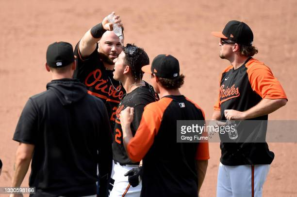 Ramon Urias of the Baltimore Orioles celebrates with teammates after driving in the game winning run in the ninth inning against the Washington...