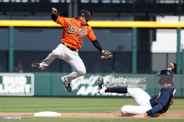 Ramon Urias of the Baltimore Orioles jumps over Peter O'Brien of the Atlanta Braves on a force play at second base in the seventh inning of a...