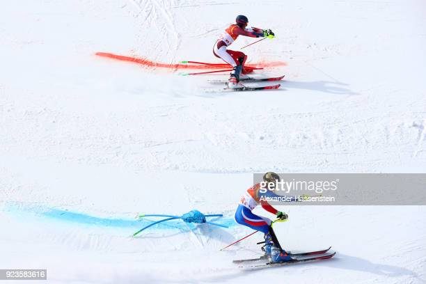 Ramon Zenhaeusern of Switzerland and Clement Noel of France compete during the Alpine Team Event semi final on day 15 of the PyeongChang 2018 Winter...