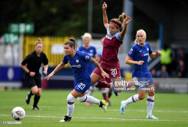 Ramona Bachmann of Chelsea is challenged by Cho SoHyun of West Ham United during the Continental Tyres Cup Group D match between Chelsea Women and...
