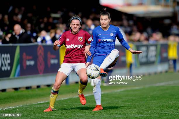 Ramona Bachmann of Chelsea passes the ball under pressure from Leanne Kiernan of West Ham United during the FA Women's Super League match between...