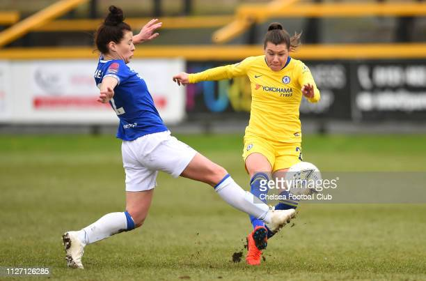 Ramona Bachmann of Chelsea shoots under pressure from Angharad James of Everton during the FA Cup Fourth round match between Everton Ladies and...