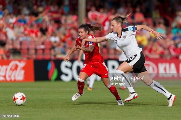 Ramona Bachmann of Switzerland and Virginia Kirchberger of Austria battle for the ball during the Group C match between Austria and Switzerland...