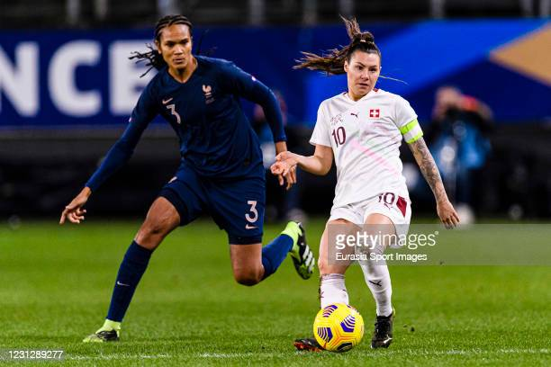 Ramona Bachmann of Switzerland plays against Wendie Renard of France during the friendly match between France and Switzerland at Saint-Symphorien...