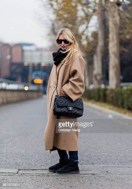 Ramona Cantisano is wearing a beige coat black Chanel bag ugg boots on January 12 2017 in Florence Italy