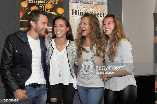 Ramona Hinterseer , her daughters Laura and Jessica with her boyfriend Timo Scheider smile at the Filmtheater in Kitzbuehel, Austria, 20 October...