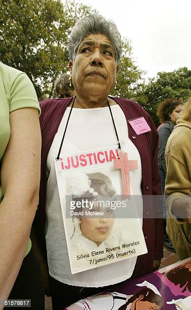 Ramona Morales wears a photo of her 16yearold daughter Silvia Elena Rivera Morales who was one of nearly 100 girls and women in Ciudad Juarez and...