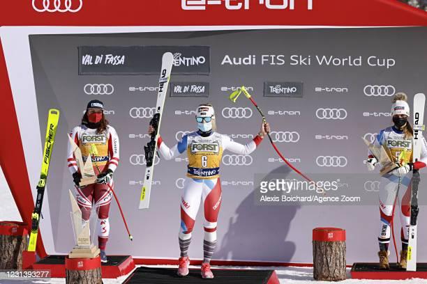 Ramona Siebenhofer of Austria takes 2nd place, Lara Gut-behrami of Switzerland takes 1st place, Corinne Suter of Switzerland takes 3rd place during...