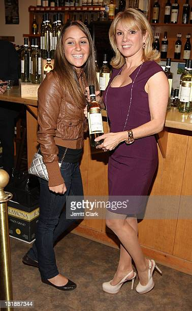 Ramona Singer poses with a fan at the Ramona Singer Pinot Grigio wine tasting and bottle signing at Vintage Grape on May 5 2011 in New York City