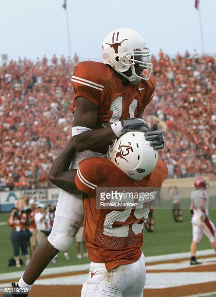 Ramonce Taylor and Jamaal Charles of the Texas Longhorns celebrate against the Louisiana-Lafayette Rajin' Cajuns on September 3, 2005 at Darrell K...