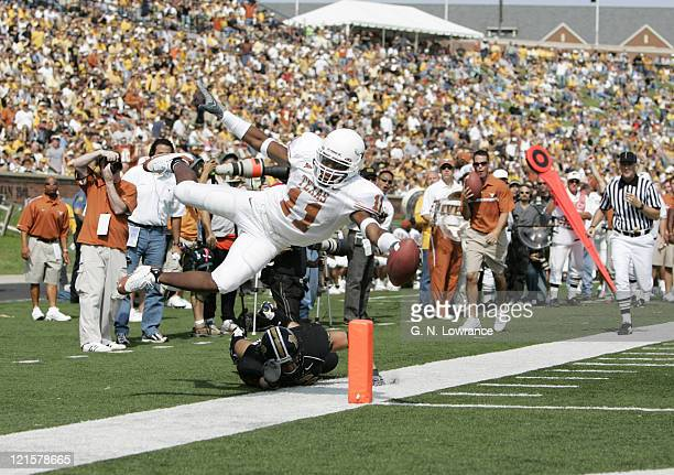Ramonce Taylor of the Texas Longhorns dives into the endzone to score against the Missouri Tigers at Memorial Stadium in Columbia Missouri Oct 1 2005...