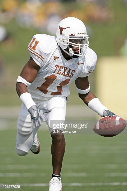 Ramonce Taylor of the Texas Longhorns eludes defenders during a game against the Missouri Tigers at Memorial Stadium in Columbia Missouri on October...