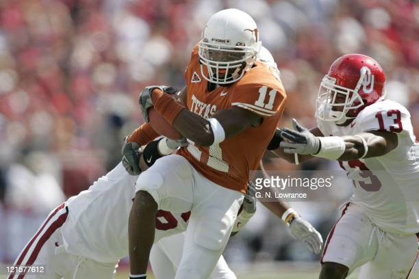 Ramonce Taylor of the Texas Longhorns in action against the Oklahoma Sooners in the 100th annual Red River Rivalry at the Cotton Bowl in Dallas,...