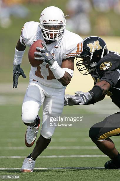Ramonce Taylor of the Texas Longhorns slices through the Missouri defense during a game against the Tigers at Memorial Stadium in Columbia Missouri...