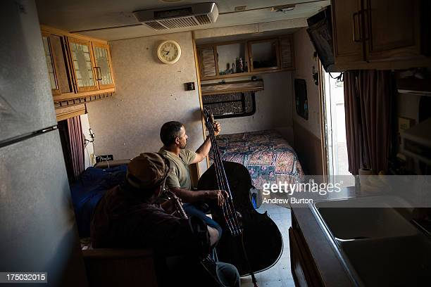 Ramone Garcia and his brother Samuel Garcia play music in their trailer on July 29 2013 in Watford City North Dakota The Garcia brothers live in the...