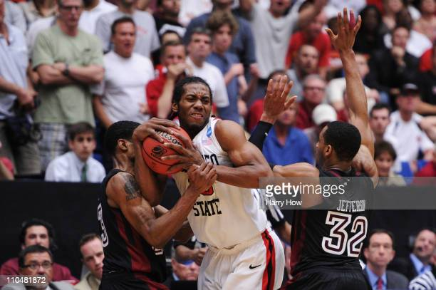 Ramone Moore and Rahlir Jefferson of the Temple Owls attempt to steal from Kawhi Leonard of the San Diego State Aztecs in double overtime during the...
